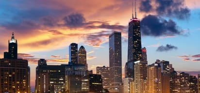 a view of the chicago skyline at dusk