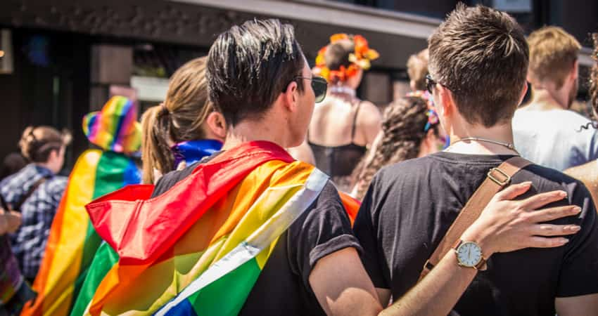 A group of people attending a LGBTQ Pride Parade