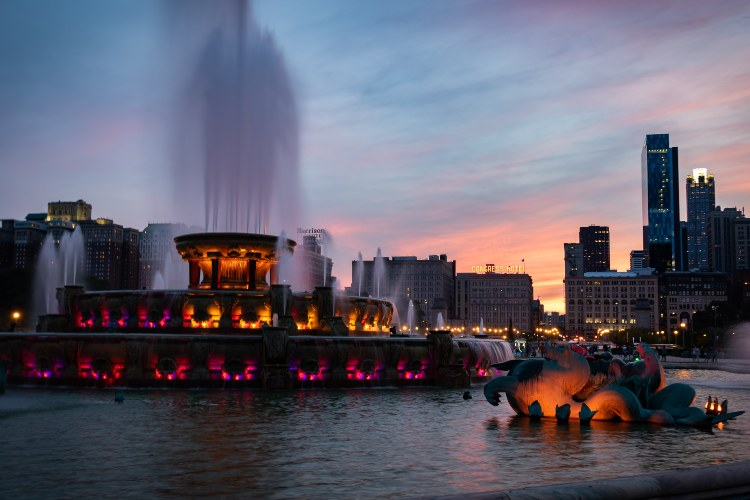 a large, ornate fountain in chicago's grant park at dusk