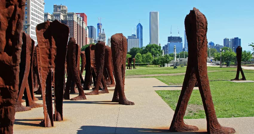 The rusty and towering forms in the Agora sculpture in Grant Park in Chicago