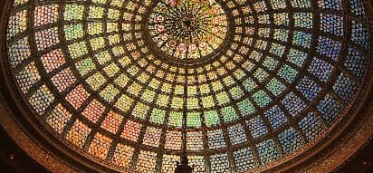 The rainbow stained glass dome roof of the Chicago Culture Center