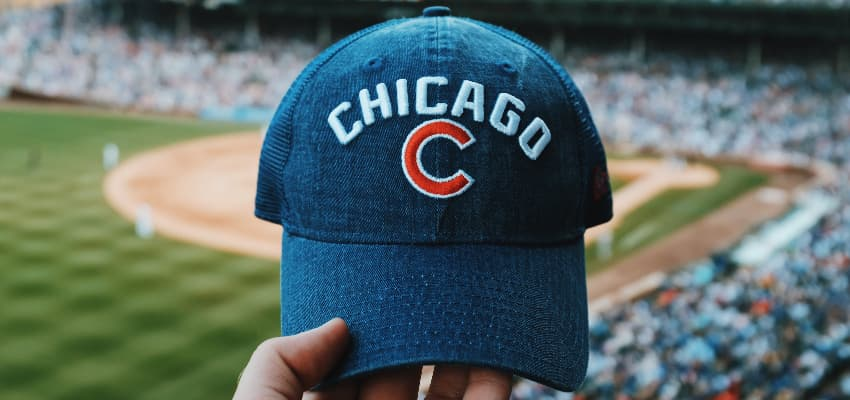 Chicago cubs fan holding a cap at Wrigley Field