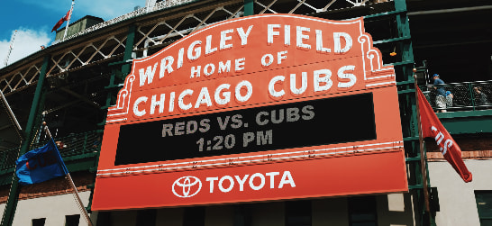 "entrance sign to wrigley field reading ""home of chicago cubs"""